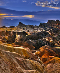 Zabriskie Point (Sandeep K Bhat) Tags: california sunset color texture clouds contrast nikon rocks dusk patterns flare deathvalley zabriskiepoint hdr d90 convolutions erorded