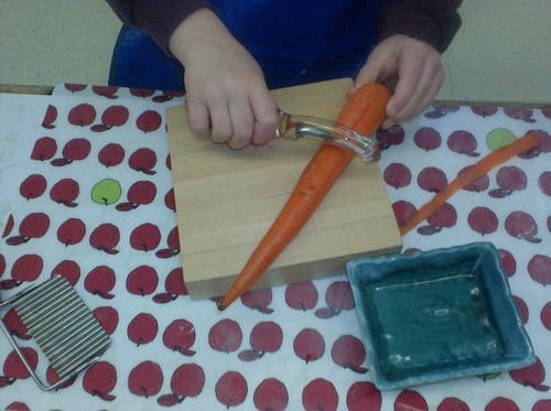 Peeling Carrots (Photo from The Moveable Alphabet)