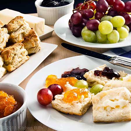 Baking Powder Biscuits on plate with butter, jam, and grapes