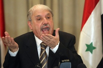 Yussef al-Ahmad, Damascus' ambassador to Egypt and the Arab League, gives a press conference in Cairo on November 12, 2011, after an emergency meeting at the organization's headquarters on the situation in Syria. by Pan-African News Wire File Photos