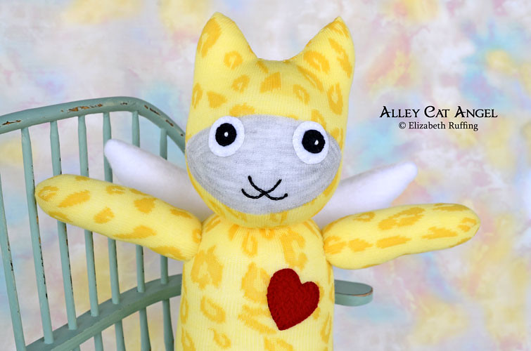 Yellow animal print Alley Cat Angel Sock Kitten by Elizabeth Ruffing