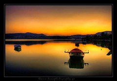 Boat in Automn Sunset... (ktania) Tags: blue red sky mountain lake color macro art colors canon landscape photography photo flickr raw cityscape background greece tamron hdr photographyart artphotography kastoria landscapephotography 400d canon400d kardpostal taniaphotography tamron18250f35 taniakoleska ktania