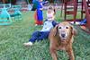 IMG_9097 (drjeeeol) Tags: dog pet halloween goldenretriever costume backyard tiger superman charlie will superhero cape supergirl triplets toddlers 2011 36monthsold