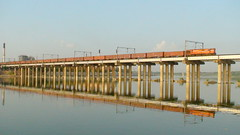 CRYSTAL CLEAR REFLECTION OF FREIGHT TRAIN TAKEN AT SABARMATI BRIDGE (arzankotval2002) Tags: sun reflection river evening udl gujarat freighttrain indianrailways bcna sabarmati westernrailway irfca waterbody 13233 wdg3a arzankotval
