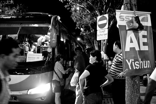 This bus goes to Yishun. You can see 2 of the organizers of the buses in the picture.