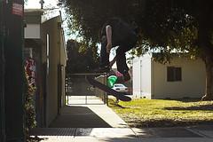 big flip (Jorge. Romero.) Tags: camera people green fence spider big skateboarding web pole panasonic flip skate skateboard leafs filming vx2100 gh1