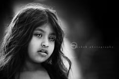|  Angel everywhere (ayashok photography) Tags: street portrait bw girl smile morninglight blackwhite kid nikon madras streetphotography chennai bnw tamilnadu rimlight parrys nikkor70200mmvr ayashok nikond300 indiaplaces hairglow aya0895