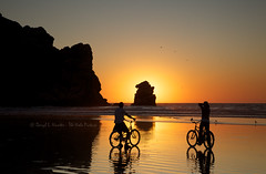 Bicyclers Sunset Silhouette [Explored] (Daryl L. Hunter - The Hole Picture) Tags: california sunset silhouette couple romantic morrobay centralcoast morrorock sanluisobispocounty bicylers beachcaliforniamorrobaysunsetbicyclerscoupleattractivemorrobayunitedstatesof tpslandscape