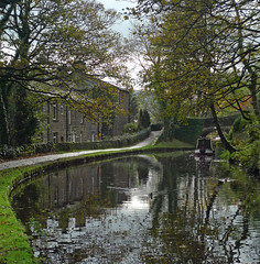 Huddersfield Narrow Canal (jrw080578) Tags: bridge autumn trees buildings reflections boats canal saddleworth narrowboats huddersfieldnarrowcanal