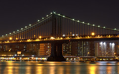 Manhattan Bridge (D. Photos) Tags: nyc nightphotography bridge water buildings lights manhattanbridge eastriver nikoncamera 70200mmlens debbiephotos d7000 manhattanbridgeatnight