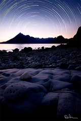 Elgol Star Trails (David Hannah) Tags: ocean sea sky mountains skye beach composite night island coast scotland rocks peace north atlantic sharp highland astronomy loch peaks peninsula celestial foreground slapin scavaig strathaird kirkibost coastuk glasnakille ealaghol summertimeuk welcomeuk