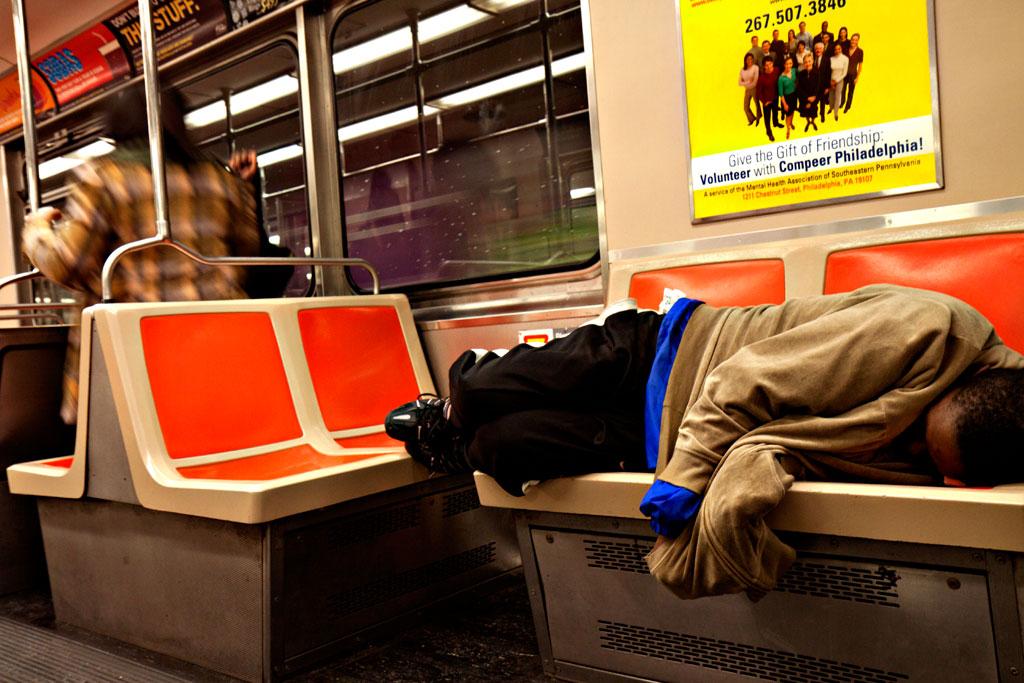 Man-sleeping-on-subway-train-on-11-16-11--Center-City