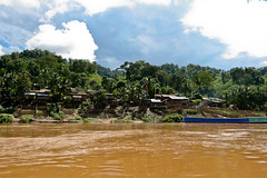 Typical Riverside Village on the Slow Boat trip down the Mekong in North-West Laos (Joe Fenton) Tags: travelling tourism water river landscape boats rainforest seasia villages backpacking laos mekong localpeople smallcommunity slowboattrip greatrivers