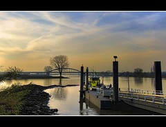 Ferry across the Rhine (Wim K) Tags: ferry bridge river rhine lek water surface reflection sky clouds magic golden blue hour boat orange yellow harbour delta estuarium holland nederland netherlands dutch canon powershot s95 stock photo stockphoto stockphotography photography wpk wpk2