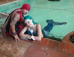 A Sweet Encounter (Spike El Pirata) Tags: california santa county orange moon pool beauty tattoo hotel ana pirates babe embassy pirate piracy spike mermaid suite oc magical daze sirena pirata pyrate 2011