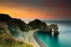 Silence. (Kevin_Mitchell) Tags: ocean morning sea england beautiful up clouds sunrise landscape early nikon long exposure wake arch colours photographer natural united year dream like kingdom calm atlantic hues lee harmony serenity dorset reality dreamy serene filters puffy f4 entry pinks 1635 d300 durdledoor nothdr jurasiccoast