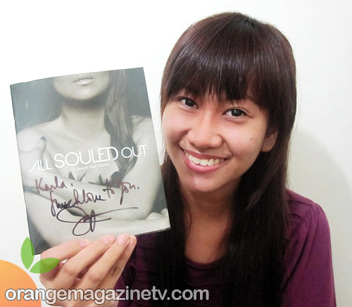 Orange Magazine TV contributor Karla Avila with her Jaya 'All Souled Out' signed album