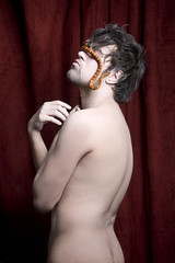 Adam (Mikael Georgiou) Tags: red man male nude religious blind snake blinded curtains form temptation sculptural judas iconography maleform cornsnake malebody stagecurtains nudesnake blindedbytemptation judassnake