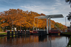 Wilhelmina Channel (BraCom (Bram)) Tags: bridge autumn trees fall netherlands trafficlight bomen herfst nederland barrier kanaal brug channel moorings noordbrabant stoplicht slagboom hefbrug wilhelminakanaal meerpalen bracom oostwestenmiddelbeers