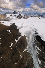 Glacial Slide (pdxsafariguy) Tags: cliff snow canada mountains ice clouds rockies nationalpark jasper aerial glacier alberta banff continentaldivide icefield columbiaicefield tomschwabel