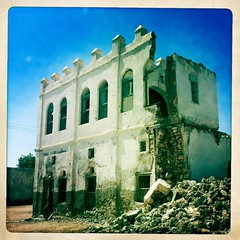 Old Turkish house in Berbera Somaliland  thru Iphone Hipstamatic (Eric Lafforgue) Tags: africa old house distortion color apple horizontal architecture buildings outdoors photo construction ancient war exterior antique nobody nopeople application barbara photograph empire afrika somali ottoman turkish somalia chromatic somaliland afrique iphone hornofafrica berbera aberration 2785 somalie britishsomaliland somali somailand   szomlia   hipstamatic soomaaliland