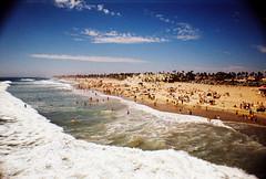 Huntington Beachtime (Kidders536) Tags: cars beach dogs boats losangeles lomography surf waves sandiego dolphins orangecounty huntingtonbeach 2011 lasardinacamera xprochrome35mmfilm