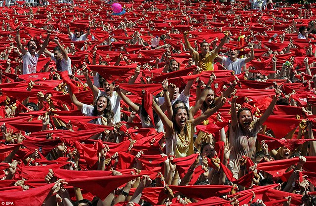 Sun, sangria and a sea of red... as Pamplona prepares for another gorefest at the running of the bulls  2