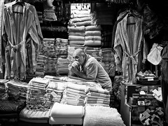 Bored to Death, Grand Bazaar - Istanbul (adde adesokan) Tags: turkey europe candid olympus istanbul trkei m43 mft mirrorless microfourthirds mirrorlesscamera