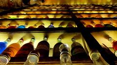 Brettos-Atene (rossomagenta) Tags: people gente drink grecia alcool nightlife colori ouzo atmosfera notte bottiglie locale divertimento pelople atene liquori brettos
