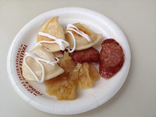 Poland - Kielbasa and Potato Pierogies with Caramelized Onions and Sour Cream ($5.00)