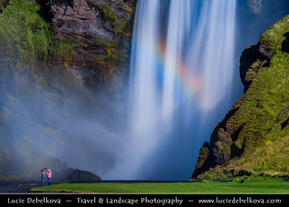 Iceland - Couple at Skógafoss Waterfall