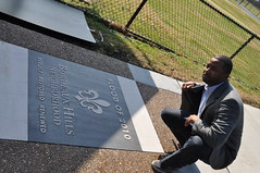 Councilman Lonnell Matthews looks over the newly installed flood memorial marker