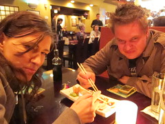 Ruth and Jeremy face off over the last piece of sushi.