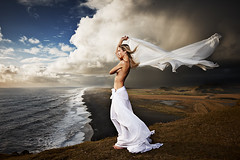 Wind (LalliSig) Tags: ocean blue portrait people woman cloud brown white beach water rain fashion yellow clouds hair landscape sand wind chiffon portraiture windswept land blown