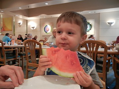Birthday boy enjoying watermelon at breakfast