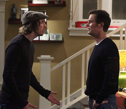 Crosby and Adam Braverman, two white men, arguing with each other near a flight of stairs