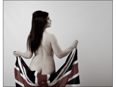 Woman poses nude except for Union flag in this stylish vintage glamour style photograph.