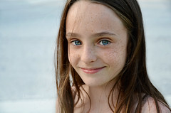 she sells sea shells (Laurarama) Tags: ocean blue portrait beach water eyes marine child freckles monalisasmile breezy odc 85mmf2 nikond7000 collectionp