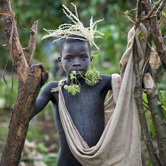 Surma kid - Omo valley Ethiopia (Eric Lafforgue) Tags: africa boy people colour childhood gabi youth outside outdoors person kid child branches jeunesse innocence omovalley shawl ethiopia tribe enfant surma naivete personne humanbeing barechest headdress contemplation afrique headwear headgear tribu dehors omo eastafrica garcon suri enfance torsenu carre abyssinia ethiopie exterieur lookingatcamera traditionalclothes waistup squarepicture 3628 abyssinie vueexterieure coloredpicture photocouleur afriquedelest surmatribe alataille etrehumain habittraditionnel suripeople valleedelomo peuplenomade regardantlobjectif turgit peoplesoftheomovalley surmapeople imagecarree peuplesdelavalleedelomo villageofturgit villagedeturgit tribudessuri suritribe tribudessurma peuplesuri peuplesurma colouredpicture cadragealataille ethiopianscarf