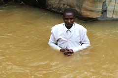 River Priest (AdamCohn) Tags: flickrtravelaward whitesuit man priest adamcohn rwanda kigali baptism water river ceremony religion christianity christian