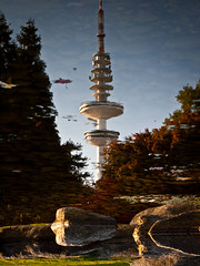 upside down // television tower, hamburg (pamela ross) Tags: autumn reflection stone pen puddle hamburg olympus fernsehturm televisiontower ep1 plantenunbloomen penpuddlereflections