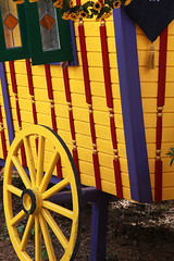 Gypsy Wagon (wyojones) Tags: flowers red usa window glass wheel yellow festival wagon texas stainedglass trf faire renfaire np renaissancefestival fest gypsy renaissance renaissancefaire renfest wagonwheel rennie texasrenaissancefestival toddmission wyojones