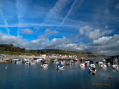 Lyme harbour (ArthurFentaman) Tags: ocean old uk greatbritain travel houses red sea vacation england sky orange holiday southwest color reflection building english heritage history tourism home nature water port marina landscape boats golden bay coast harbor boat town seaside fishing sailing unitedkingdom harbour yacht britain space postcard lifestyle craft security tourist calm quay coastal shore maritime dorset mooring boating coastline british leisure yachts picturesque vacations jurassic waterside trawler harborside lyme regis buoy harbourside quayside yachting moorings anchored moored topshots