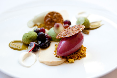 Pistachio cakes with grapes, almonds, and candied pistachios, pistachio ice cream and grape sorbet