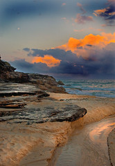 Storm out to sea (edwinemmerick) Tags: ocean sea sky cloud moon storm 20d beach water weather canon eos coast sand rocks stream shoreline sydney australia shore nsw inlet edwin bronte emmerick edwinemmerick