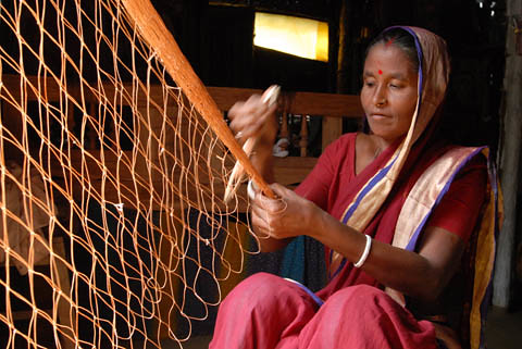 Woman weaving a fishing net, Bangladesh. Photo by WorldFish, 2006