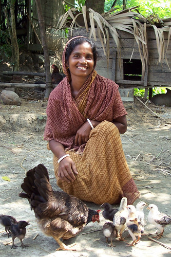 Woman and her livestock, Bangladesh. Photo by WorldFish, 2004