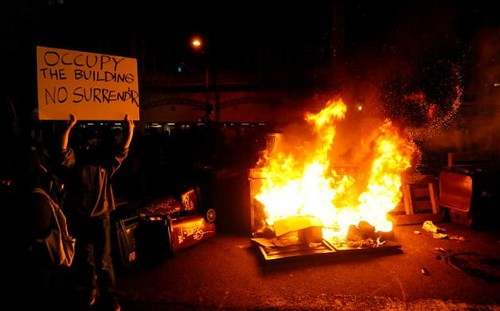 Occupy Oakland burns bonfires in downtown in the aftermath of a general strike against repression. There were thousands who marched through the city on November 2, 2011. by Pan-African News Wire File Photos