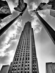 GE Building (Plotz Photography) Tags: city nyc newyorkcity sky urban blackandwhite bw ny newyork building tower up clouds skyscraper manhattan rockefellercenter center flags midtown nyny rockefeller newyorknewyork newyorkny gebuilding
