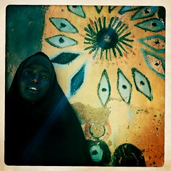 Sheikh Hussein woman Somaliland thru Iphone Hipstamatic (Eric Lafforgue) Tags: africa portrait distortion color apple wall outdoors graffiti photo war pattern exterior veil muslim islam application photograph afrika somali somalia chromatic islamic somaliland afrique iphone hornofafrica muralpainting aberration alshaykh onepersononly onewomanonly 2851 somalie oneteenagegirlonly africanethnicity achromatism britishsomaliland somali somailand   szomlia   hipstamatic blackethnicity soomaaliland teenagegirlsonly